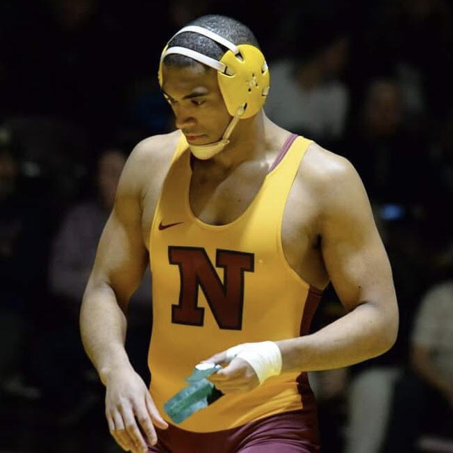 Justice Horn, openly gay college athlete, at a wrestling match in college