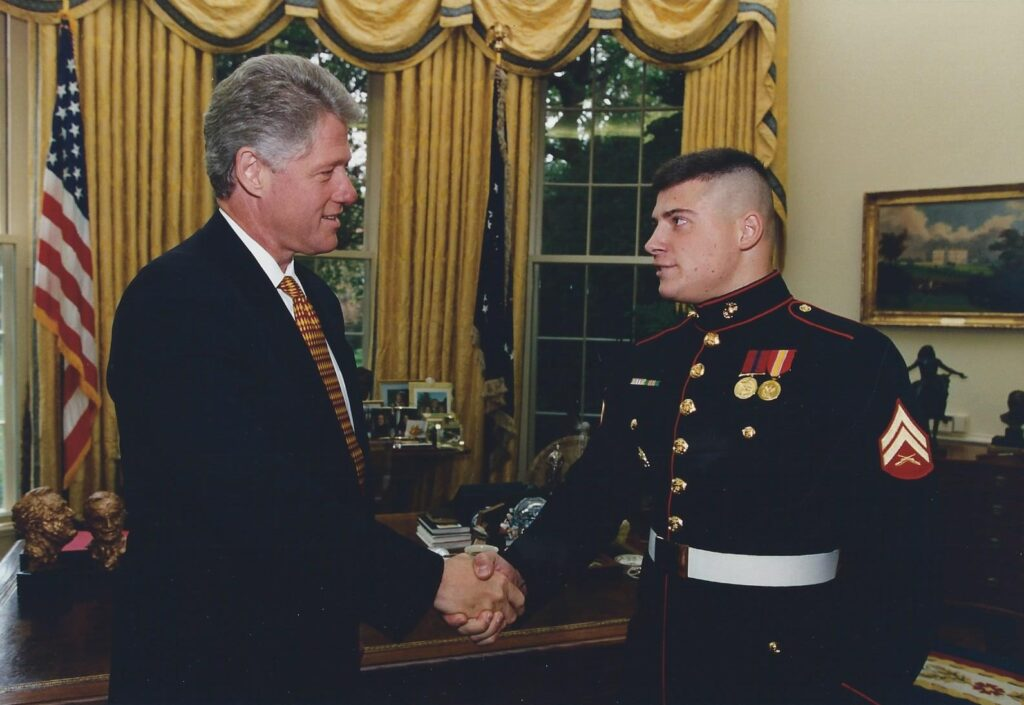 Janae Marie Kroc during her time as a Marine with President Clinton