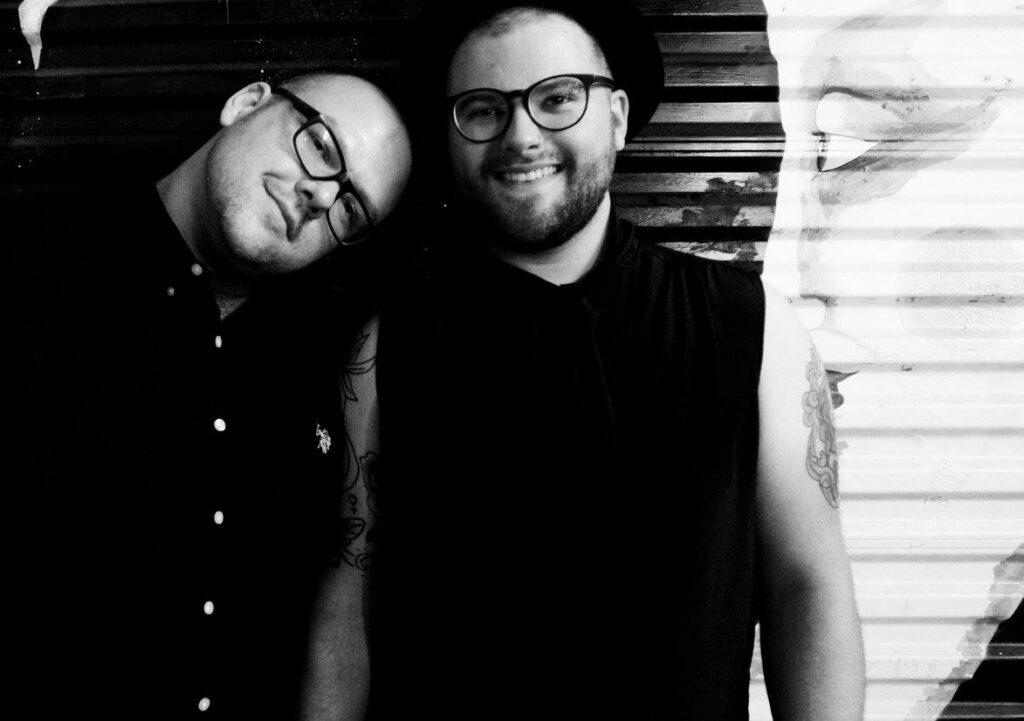 Derick Stevens-Jones (left) and their partner Evan in Louisiana